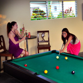 Enjoy a game of pool at Turtle Bay Dive Resort