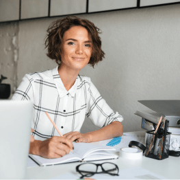 Woman working at desk smiling