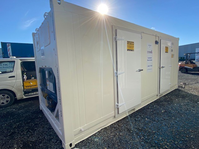 refrigerated container with an extra machine for build-in redundancy, side entry personnel doors, outside container