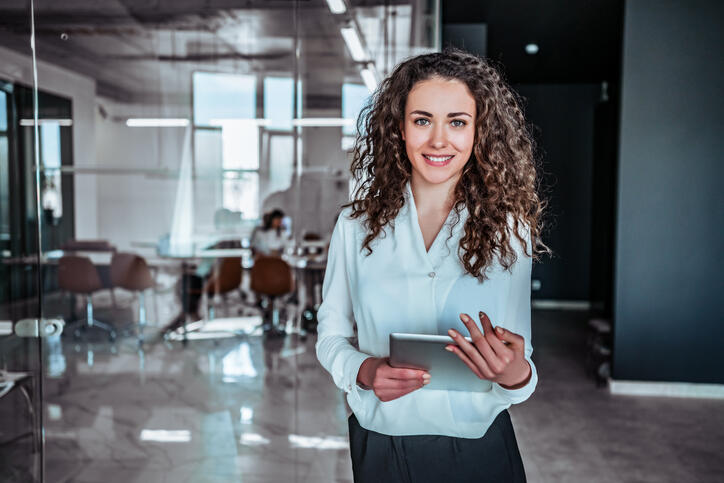 Modern business woman, human resources, employee, smiling woman holding ipad in office