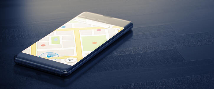 GEO TARGETING on a Mobile Phone. Online Map on a Screen. Close-up Image of Modern Smartphone with Mao or Geo Tracking on Dark Surface. Map Tracking or Geolocation Concept. 3D Render