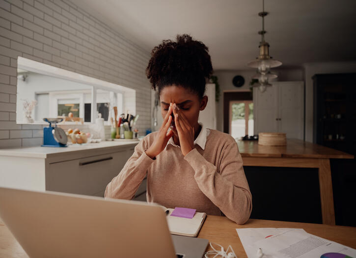 Stressful african american businesswoman holding nose bridge, suffering from communication fatigue from too many emails