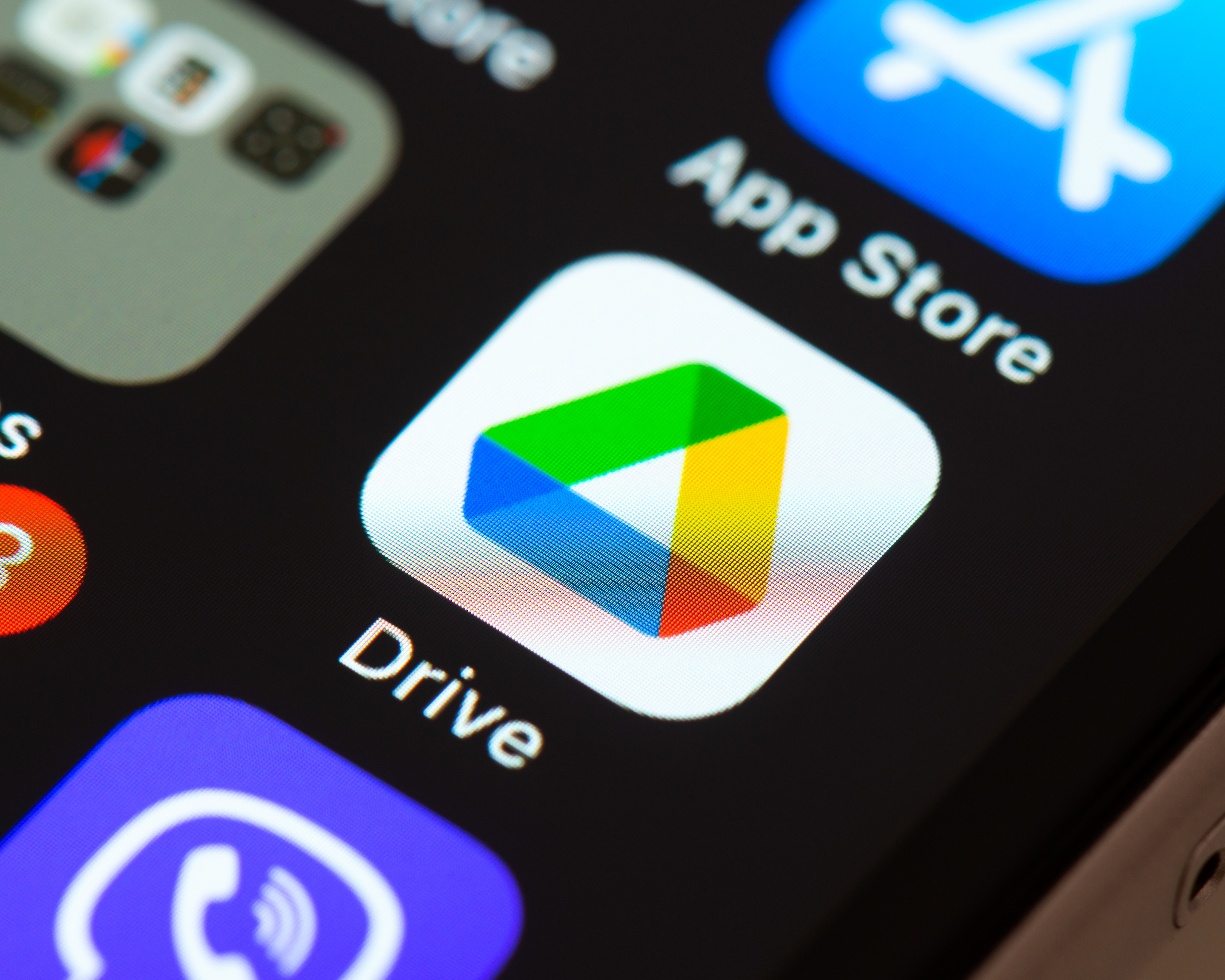 Google Drive app icon on Apple iPhone screen.