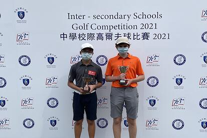 YCIS students both holding trophies from the Hong Kong Golf Association Tournament