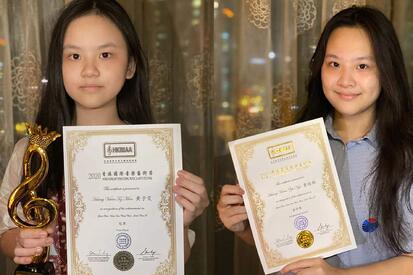 YCIS Enthusiastic Violinist Sisters Awarded in Music Competitions