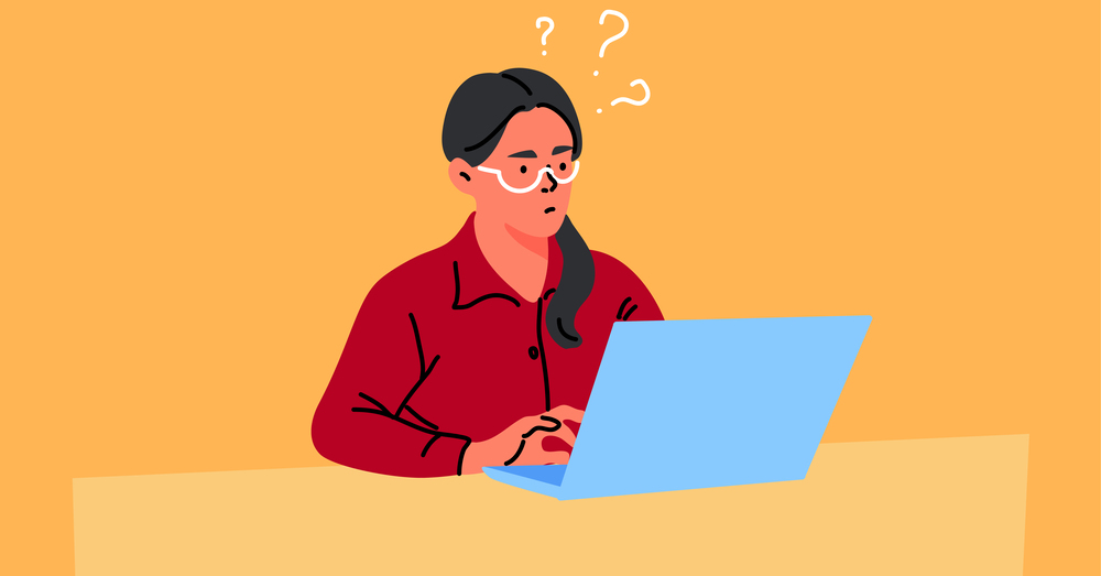 Confused woman working on laptop