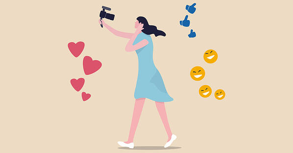 Animation of female influencer with camera surrounded by emojis