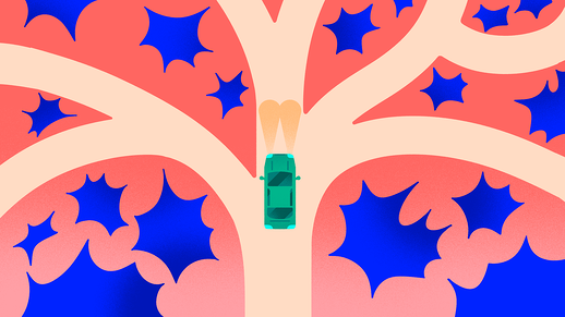 A green car in front of a crossroad