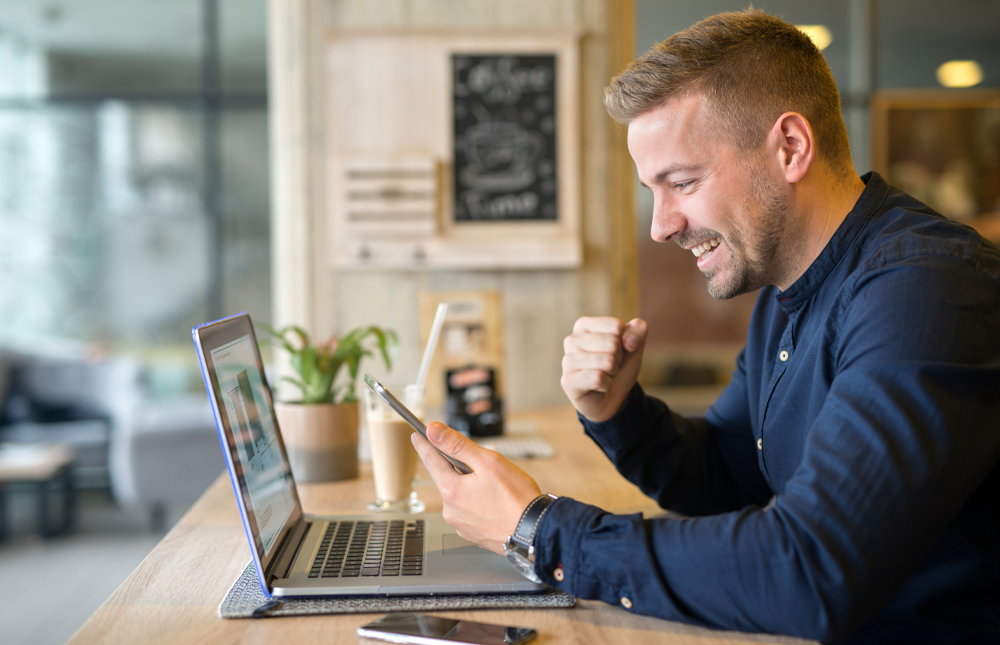 man excited after using turbotax discount for his taxes