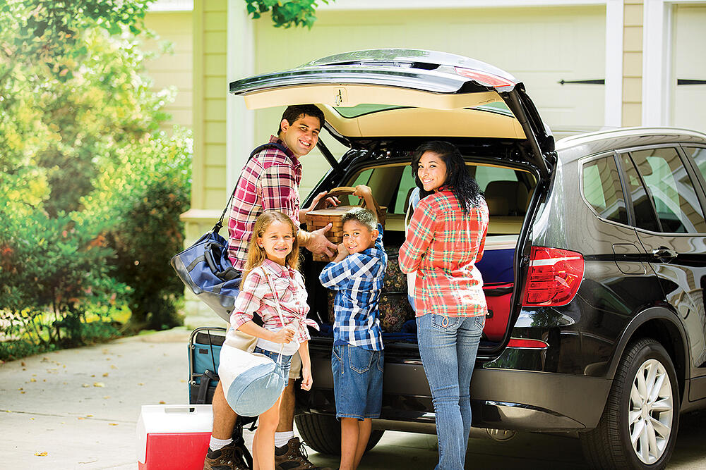 Family Loading a Car