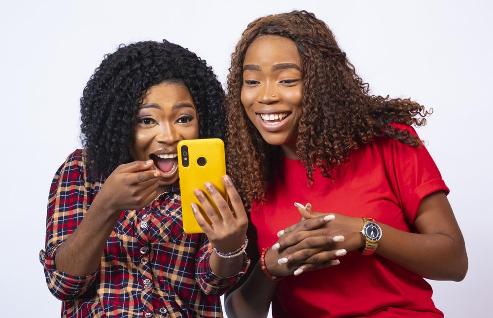 millennials looking at their Kasasa Saver Account on their phone