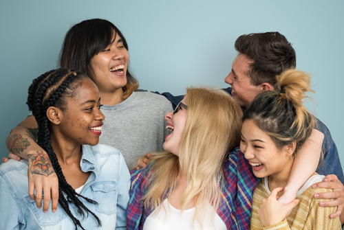 teens in a group laughing