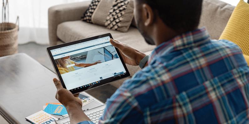 Man using LinkedIn on tablet