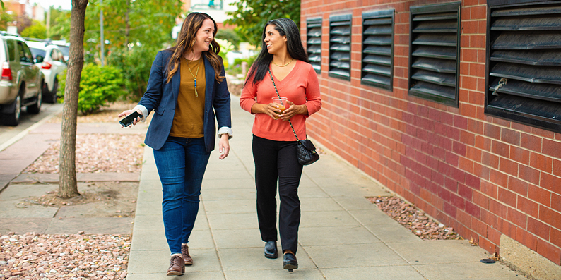 Women walking and talking