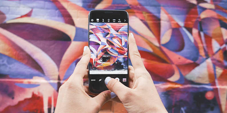 Taking photo of a mural on phone