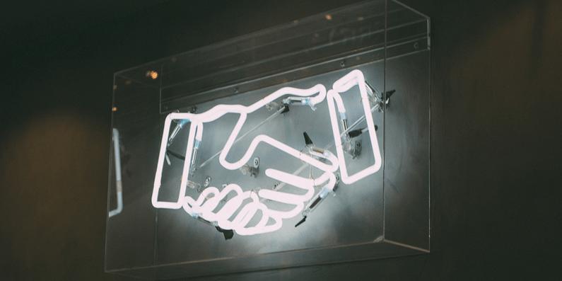 Neon light handshake