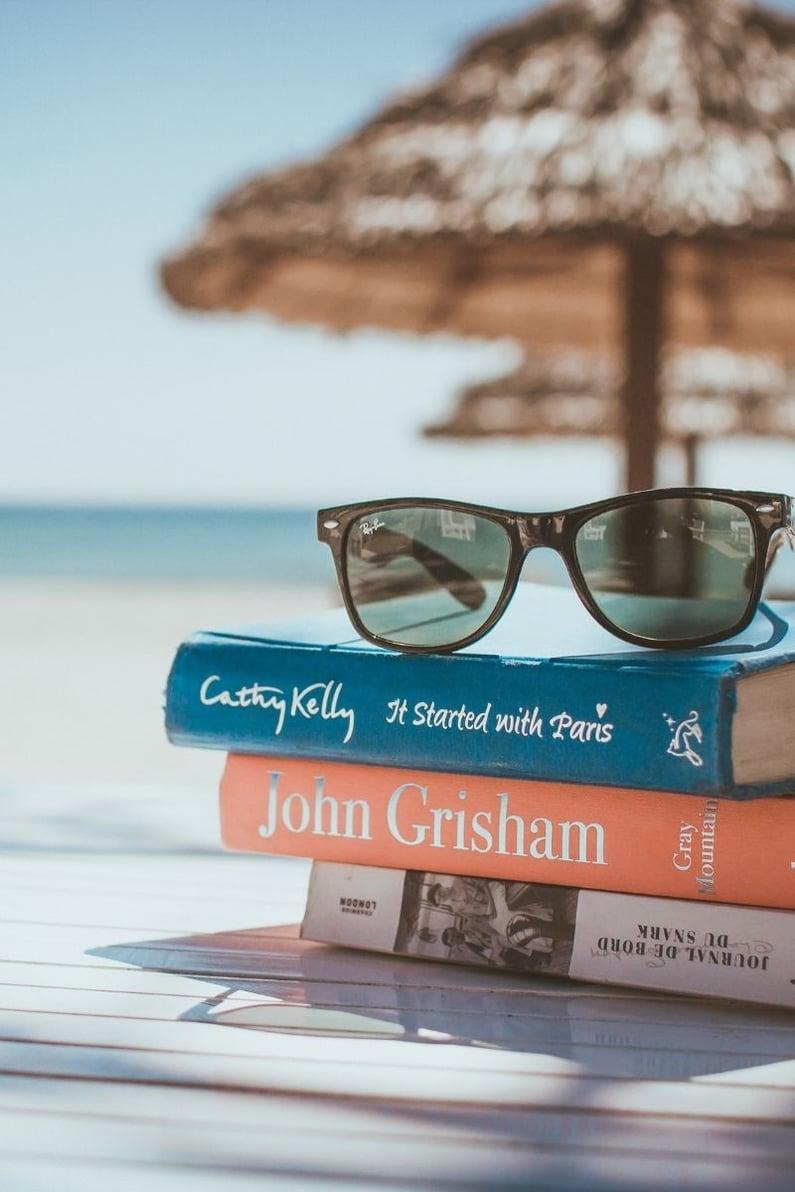 Books and sunglasses at beach