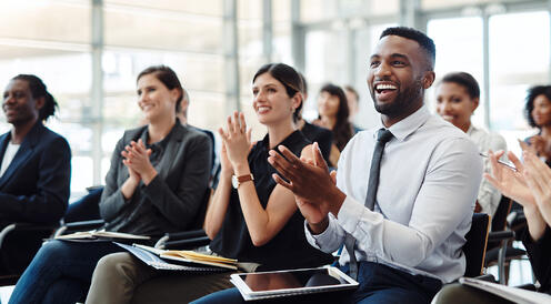 employees clapping for diversity and inclusion in the workplace