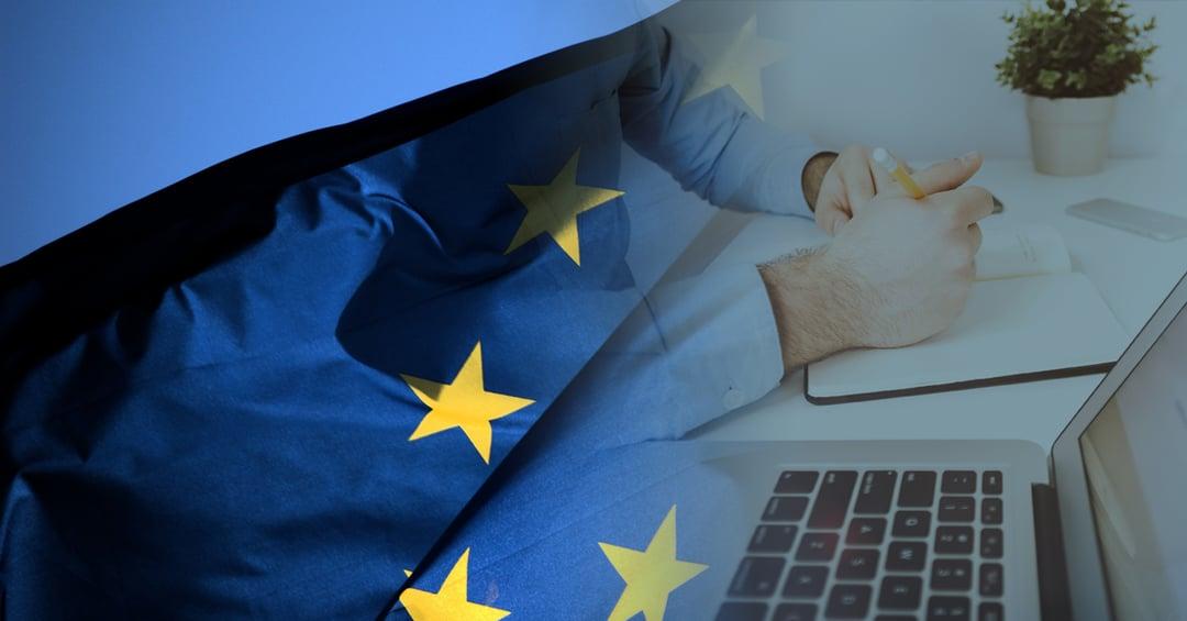 Manipulation of laptop overlaid with European Union flag to denote legislation