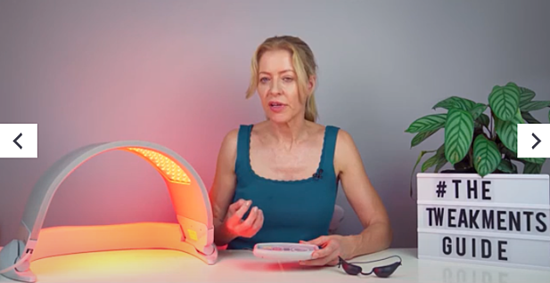 woman talking next to glowing LED light canopy