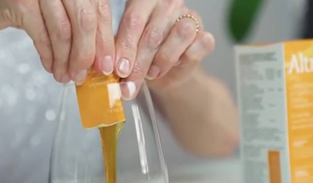 Altrient vitamin C being squeezed into a glass