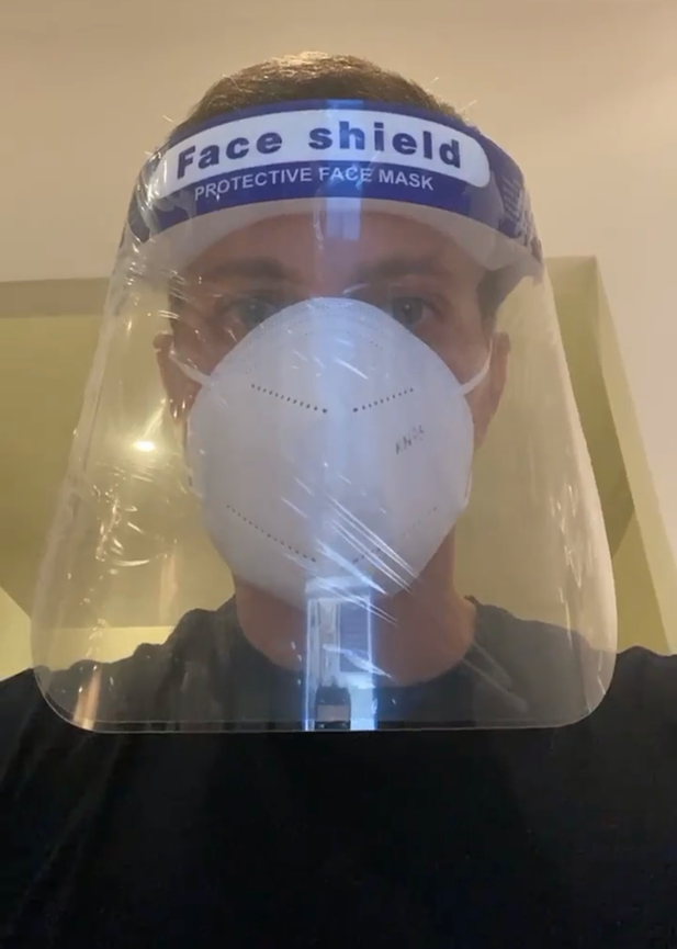 Dr Wassim Taktouk of the Dr Rita Rakus clinic in Knightsbridge, London, wearing PPE including a surgical mask and face shield