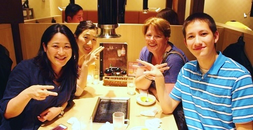 sukiyaki in Osaka Japan with friends Teach and travel the world