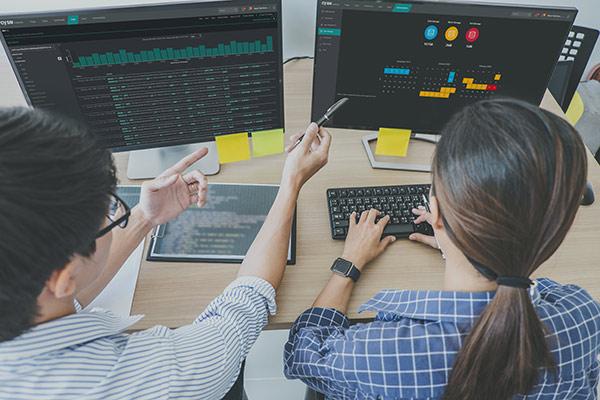 SOC analysts work on desktop computer.