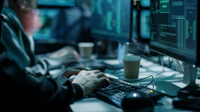 Close-up shot of a hacker using a keyboard.