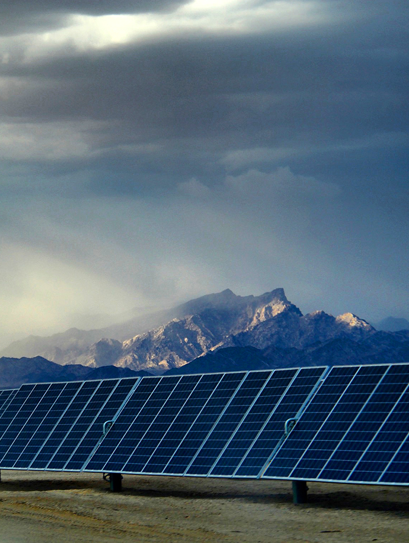 Solar grid with mountain in the background
