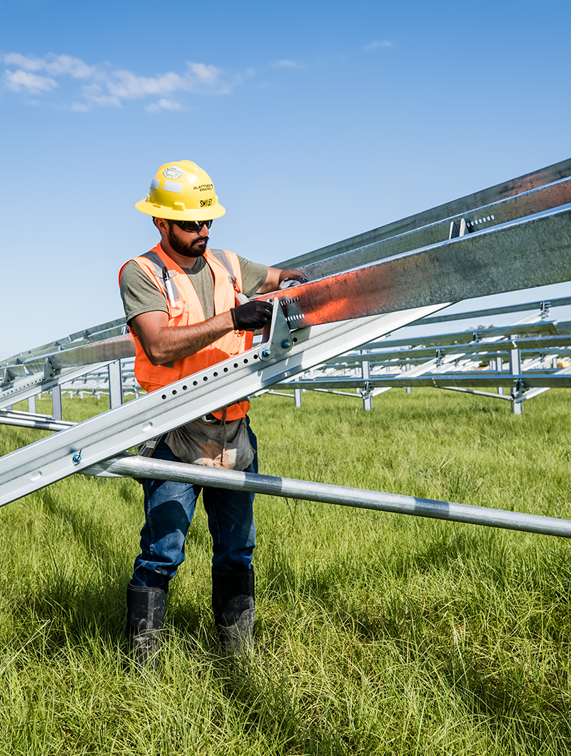 Employee working on solar grid