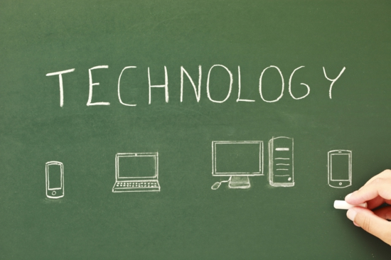 the word technology and computers drawn on a chalkboard