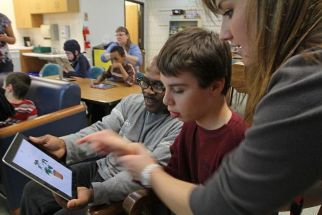 disabled students with iPads in the classroom