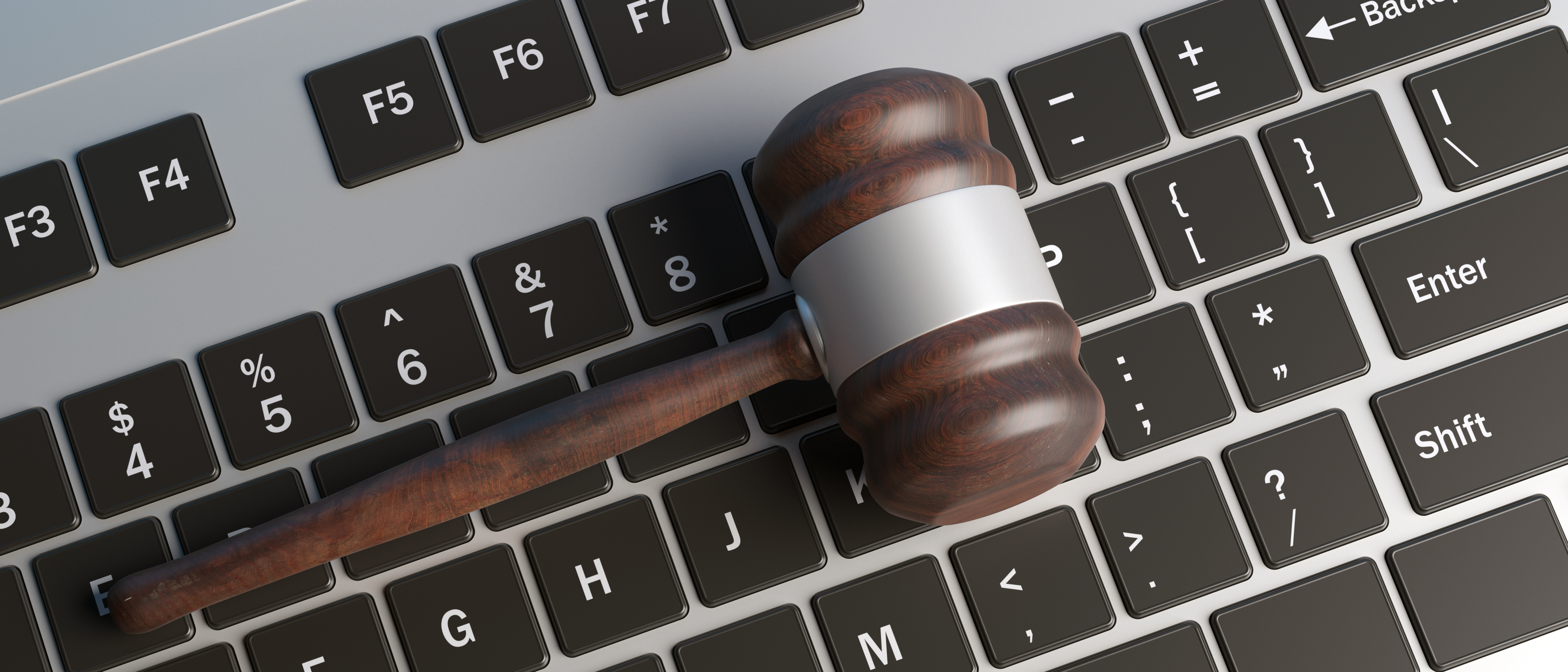 cyber-crime-concept-law-gavel-on-computer-keyboard-WENM2GD