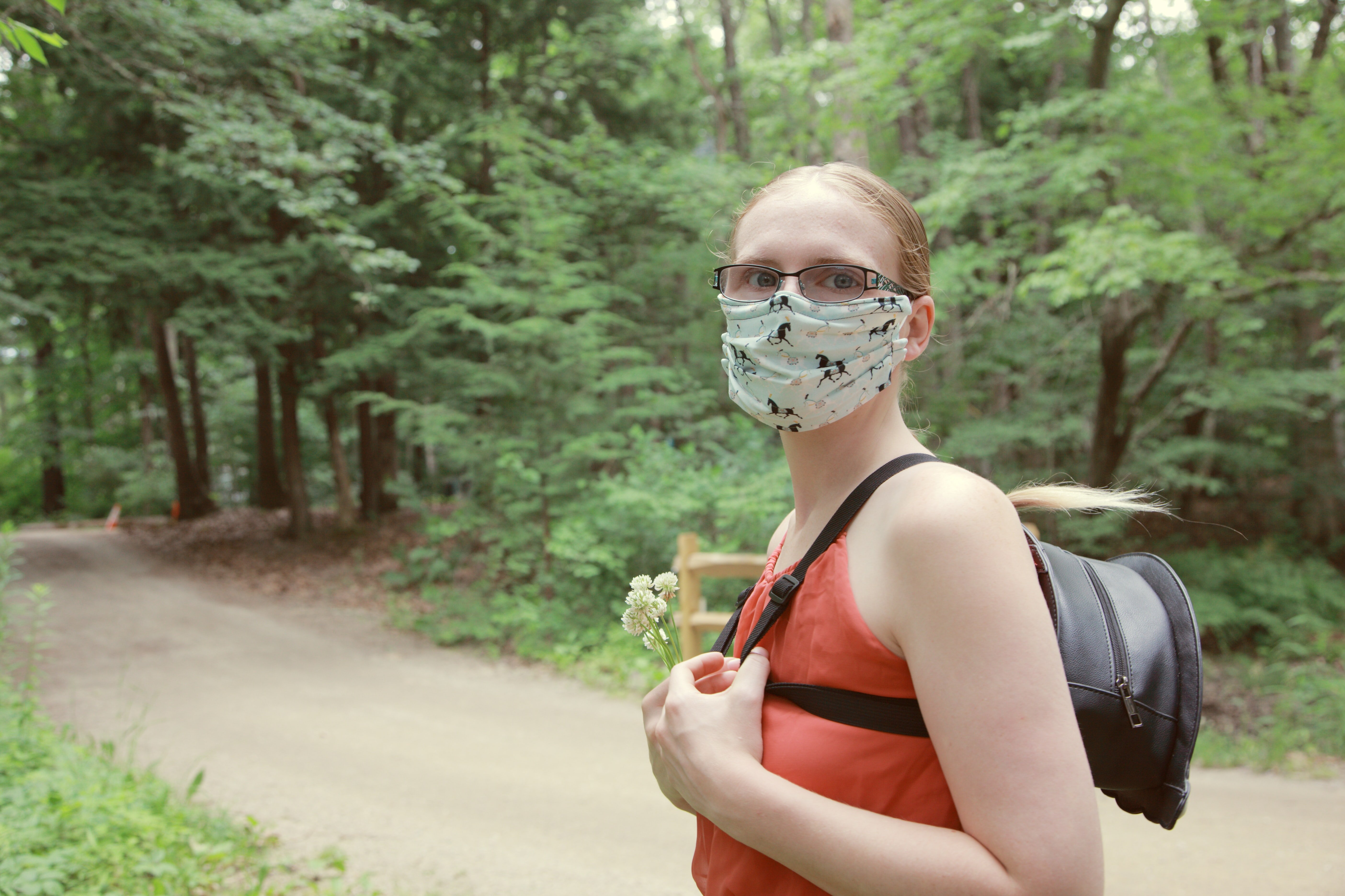 Woman exploring the forest with a mask