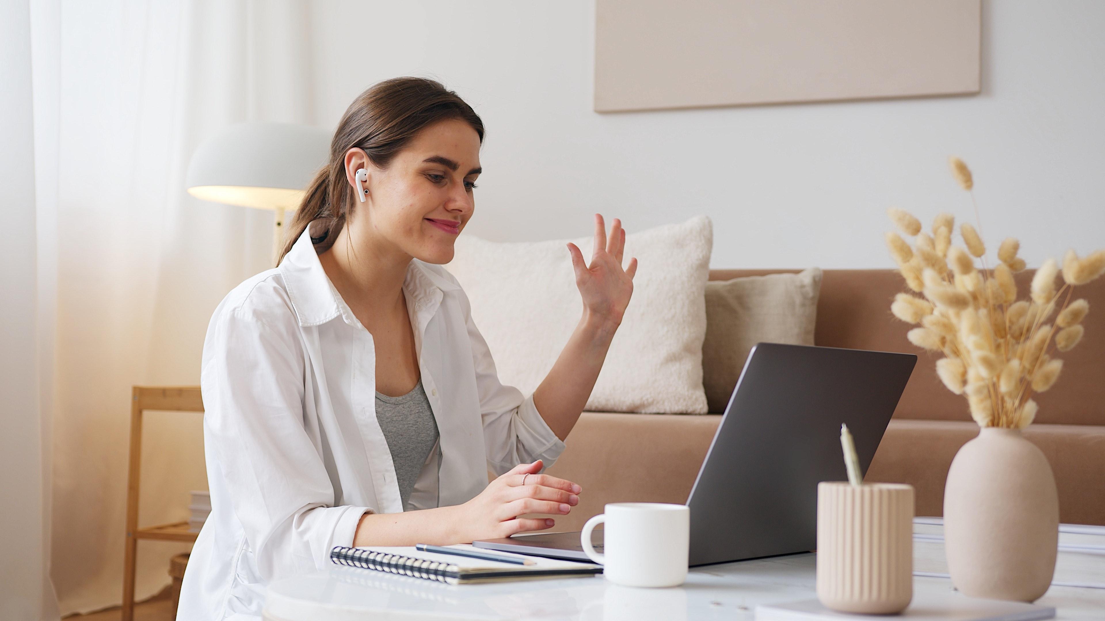 cheerful-woman-having-video-call-via-laptop-4492135