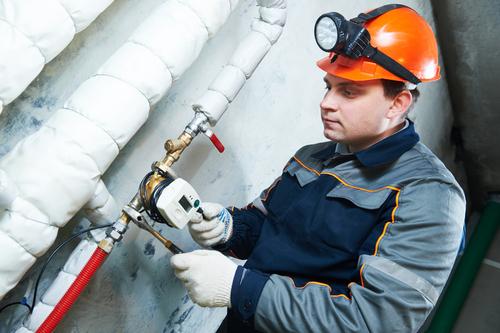 plumber fixing water meter