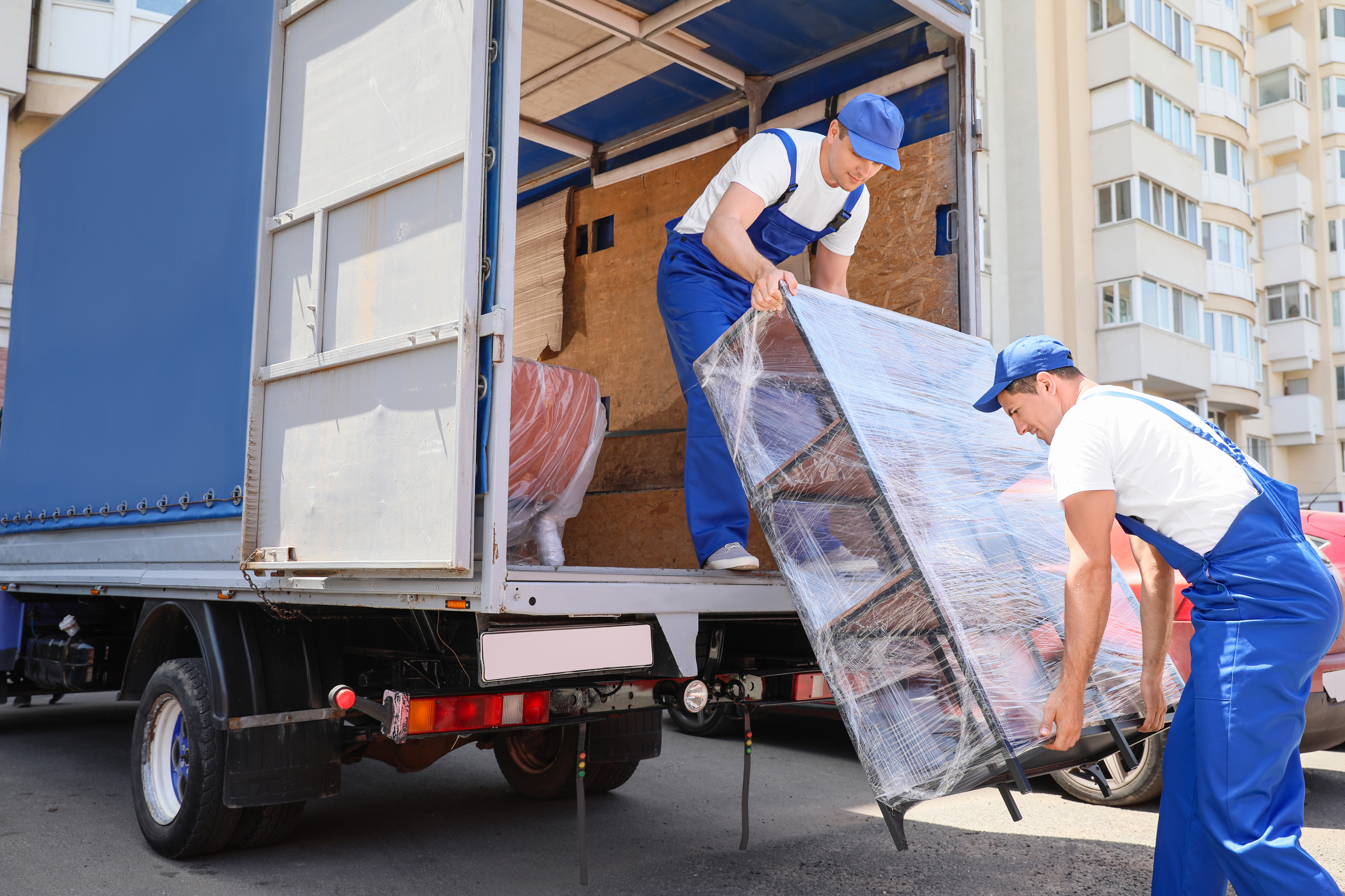 men unloading furniture from delivery truck