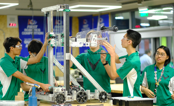 FIRST Robotics participants building a robot